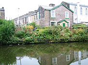 Stone terraced housing and industry on the canal bank