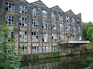 Old stone built mill or warehouse in need of refurbishment