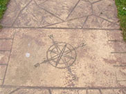 Compass directions etched into towpath