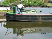 Painting a barge at Crooke