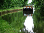 A not so narrow boat approaching Farnhill Wood