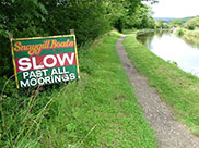 'SLOW' past all moorings