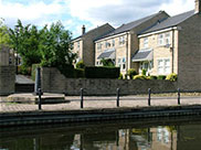 Houses and cannon at Apperley Bridge