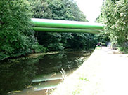 Two huge pipes traverse the canal