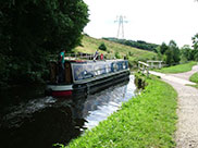 A narrowboat passes Buck Hill swing bridge