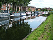 Moored boats and canalside apartments
