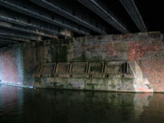 Underneath the railway bridge, evidence of widening