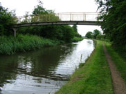 A narrow footbridge crosses the canal