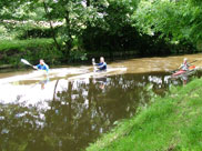 3 canoeists on the canal
