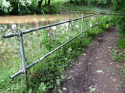 Scaffolding fence along towpath