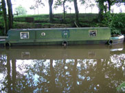 A mucky narrow boat, looks like it has been there a while