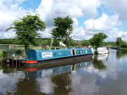 A 'green' narrow boat with a wind generator