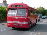 An old red Ribble bus