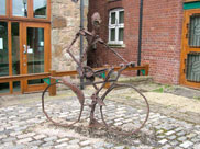 Sculpture of man on bicycle