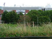 Blackburn End stand of Ewood Park visible from the towpath