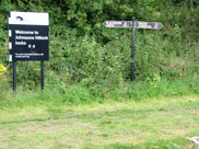 Signpost and milage markers at the bottom lock